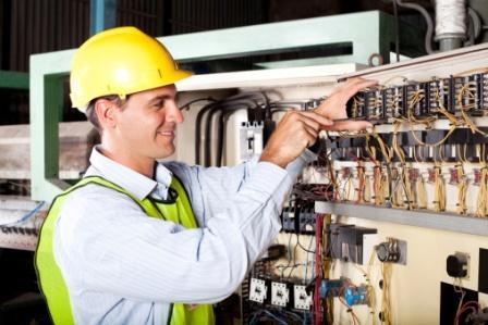 electrician reapairing industrial machine